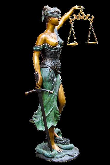 Figura bogini sprawiedliwości i bezpłatna pomoc prawna dla każdego